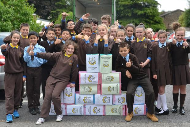Pupils at St Clare's Primary School Harolds Cross Dublin give the CWUHA convoy the thumbs up.
