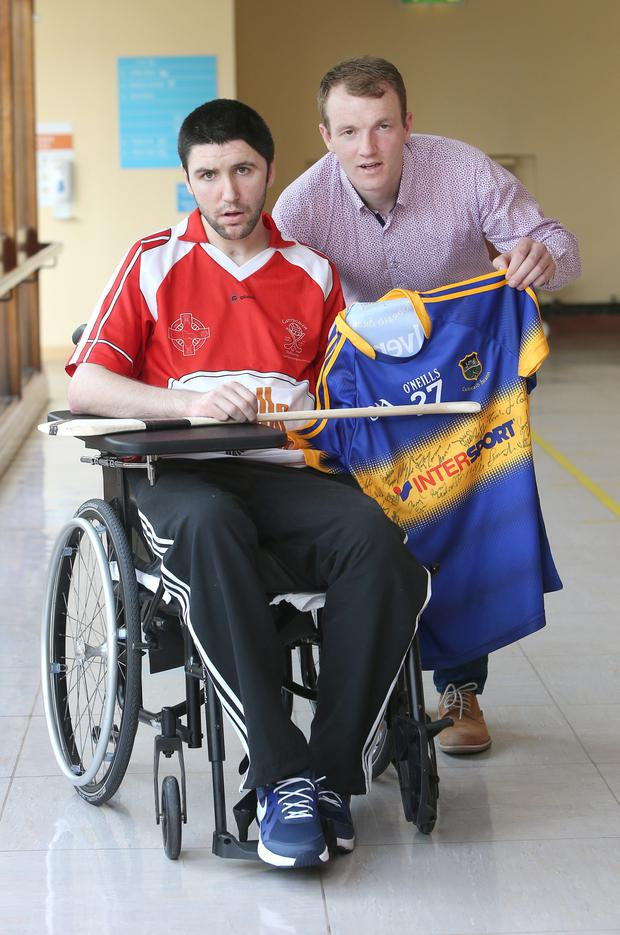 Shane vickers, 27 from, Kilmacanogue. Co Wicklow meets Tipperary hurler, Lar Corbett who presented him with a signed Tipperary jersey, Lar meet Shane who is in rehab at the National Rehabilition Hospital in Dun Laoghaire after being knocked down by a car last October after sustaining a brain injury. Picture credit; Damien Eagers 1/7/2015