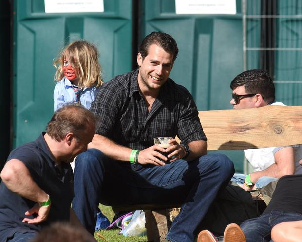 Henry Cavill enjoys a pint of Guinness at the Groove Festival in Bray