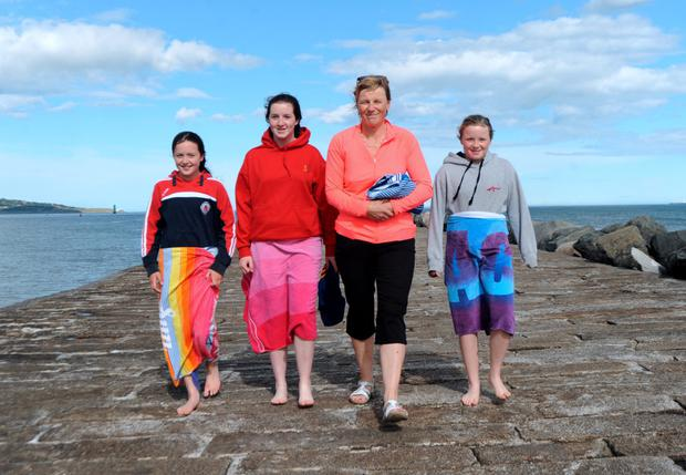 Orla Courtney, from Drumcondra, with daughters Grace O'Donnell, left, 11, and Ciara, 11, right, with pal Lizzy Gough, 2nd from left, 14, from Newmarket on Fergus, Co. Clare. Great South Wall, Poolbeg, Dublin. Picture: Caroline Quinn