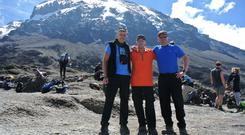 Kevin Gormley (centre) with his sons Fergal and Cathal at Kilimanjaro.