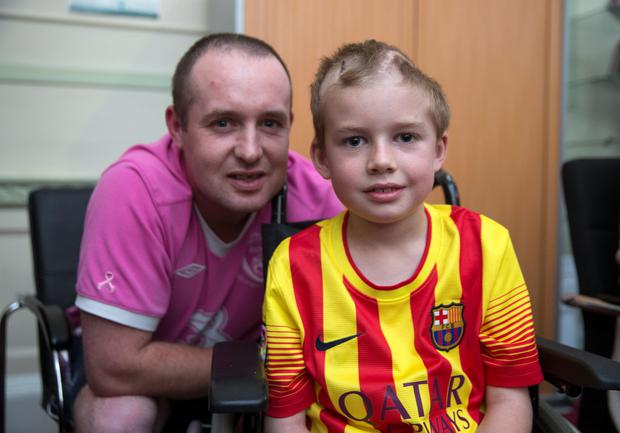 Cian Higgins, age 7, Naas and his father Ray at Temple street Hospital in Dublin. Picture:Arthur Carron