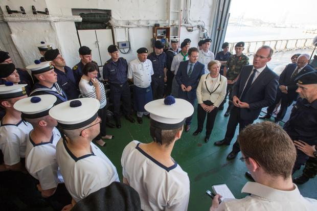 Ministers Simon Coveney, Frances Fitzgerald and Sean Sherlock with crew of the LE Eithne after docking in Valetta, Malta
