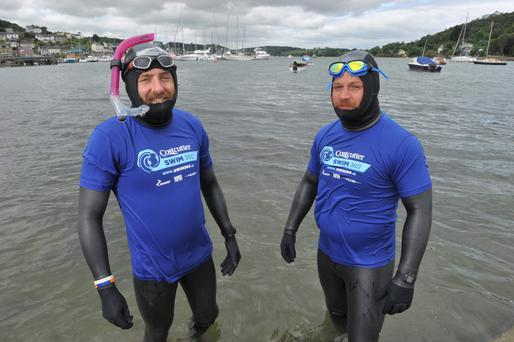 After one month, having swam 300km from Dublin, Irish Adventurers Maghnus Collins (snorkel) and David Burns of Costcutter 360 Swim Team pictured arriving into Crosshaven, Co Cork Pic Daragh Mc Sweeney/Provision