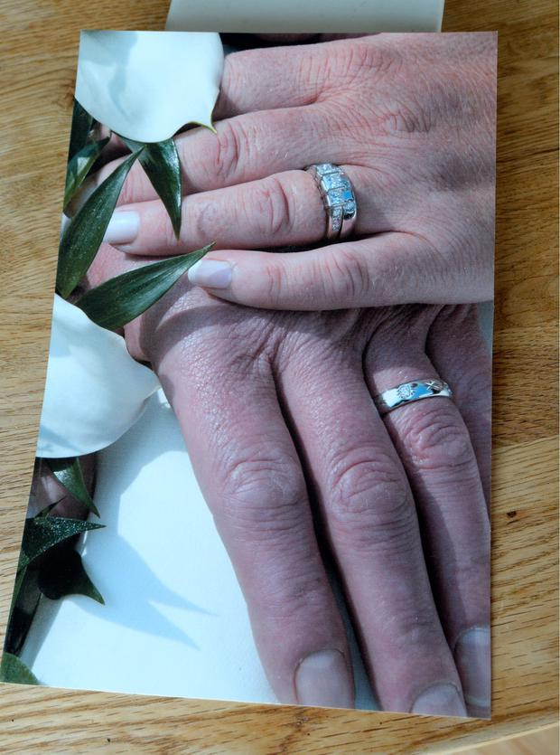 Suzanne D'Arcy and her late husband's hands and wedding rings on their wedding day