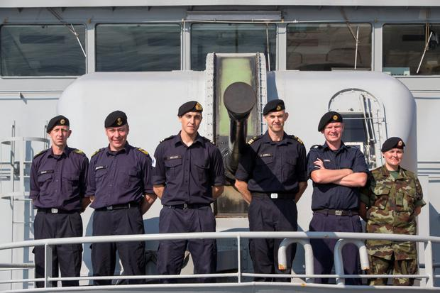 (second from right) Doctor Cummins on board the LE Eithne after docking in Valetta, Malta