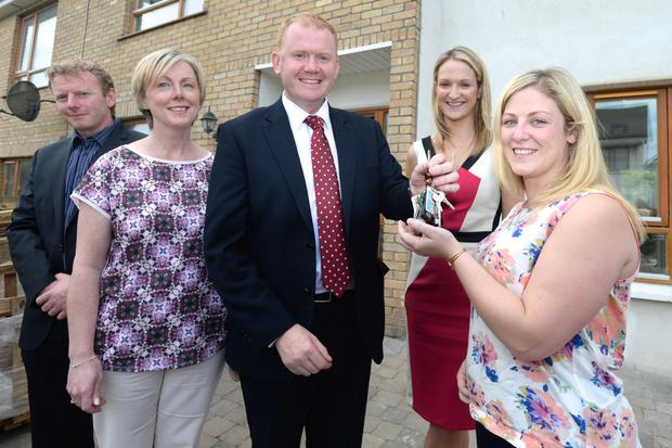 Jenny Doyle pictured with Minister for State Paudie Coffey, Regina Doherty T.D and Helen McEntee T.D pictured at her home in Ashewood Green Ashbourne after getting back the keys to her house after a Pyrite problem