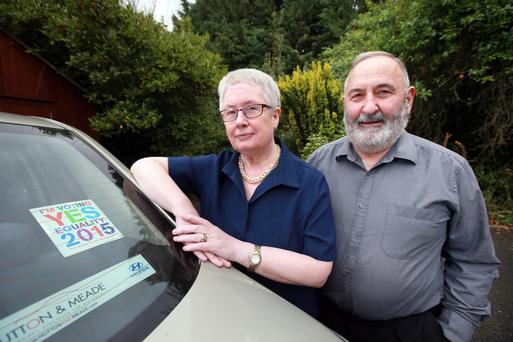Lucy and John Keaveney pictured with YES Equality car sticker which they were asked to remove because the car was parked in the grounds of a church.