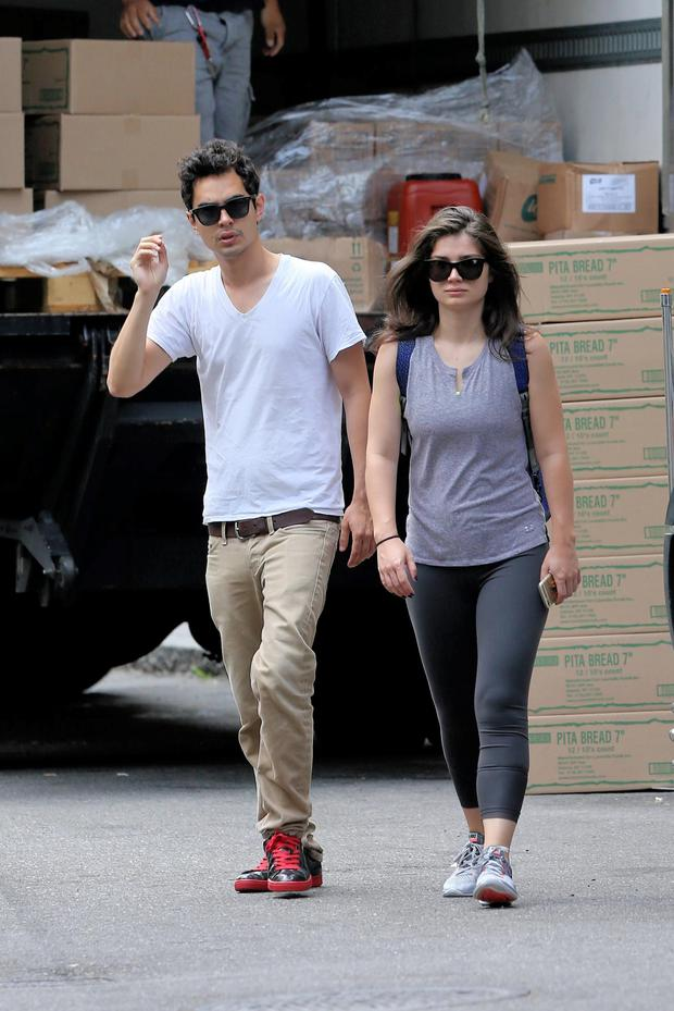 Actress Eve Hewson walks with her boyfriend, Max Minghella, in Soho in New York City