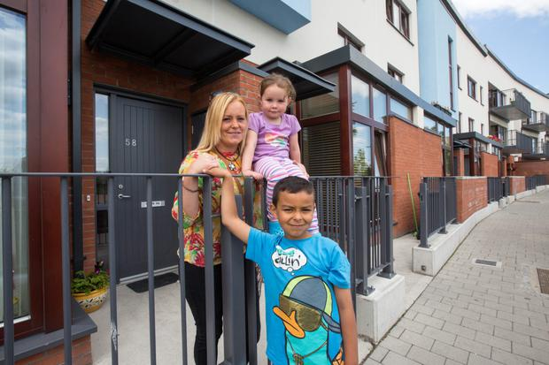 Resident Aoife Kavanagh and her children Sebastian (6) and Saffron (3) at their new home in Ballymun and who attended the official opening of the Coultry Housing Development by Minister Kelly.