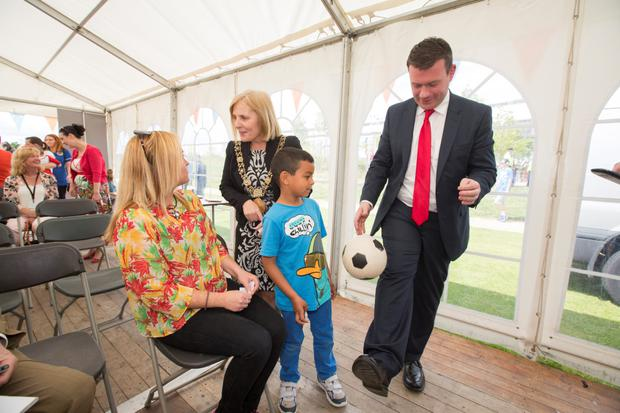 Minister Alan Kelly shows his skills to new resident Sebastian Kavanagh (6) after the Minister officially opened the Coultry Housing Development in Ballymun. Also inlcluded are Aoife Kavanagh and Lord Mayor of Dublin, Críona Ni Dhálaigh