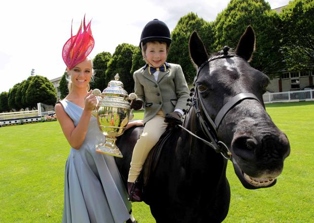 Pictured is model Gracie and eight-year-old Jack Lennon with 'Ebony Flash Miss' from Callan, Co. Kilkenny at the launch of the 2015 Discover Ireland Dublin Horse Show