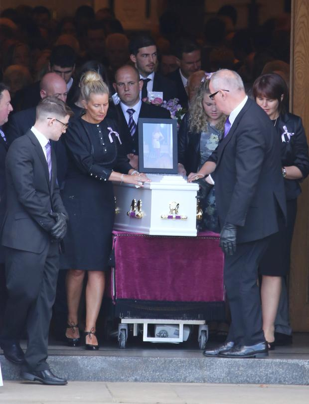 Tory's family and friends with her coffin