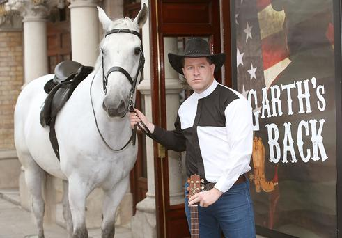 Maclean Burke as Garth Brooks at The Gaiety Theatre Dublin when he announced details of Fiona Looney's new play