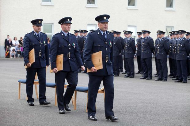 Gardai (l to r) Joseph Glackin, Gavin Cahill and Michael Bolton who were awarded the Bronze Scott Medals