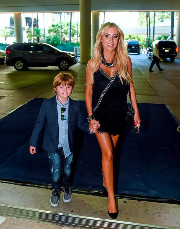 Claudine Keane and her son Robert, six years, arrive for a Special Olympics Ireland reception to celebrate the Special Olympics World Summer Games. The L.A. Hotel Downtown, Figueroa St, Los Angeles, United States