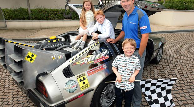 Golfer Padraig Harrington takes time out from the fairways to join Fen Flannelly (5, Ros Bannon (7) and Daragh Gorman (5) in an authentic Delorean to launch Cannonball 2015 in aid of the Make-a-Wish Foundation