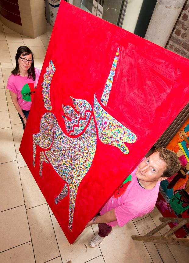 Aideen Lynch, Visual Arts Co-ordinator with Al Russell, Marketing Manager, The Ark pictured hanging The Childrens' Fingerpaint Painting at a Photocall at The ARK, Children's Cultural Centre, Eustace St.