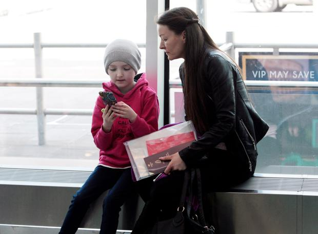 Ten year old Robyn Smyth with her mum Bernadette Dornan... at Dublin Airport,,heading off to Michigan for specialist Cancer treatment