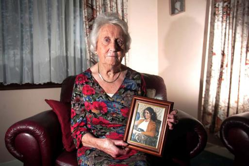 Gertie Shields in 2009 at her home in Ballbriggan poses with a picture of her daughter