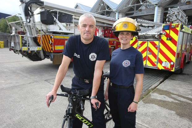 Brian Doyle, Fireofficer Dun Laoighaire Station and Liz Hanley, Fireofficer, Dolphins Barn who are taking part in the IRONMAN 70.3® Dublin triathlon this sunday. Picture credit; Damien Eagers / Irish Independent 6/8/2015