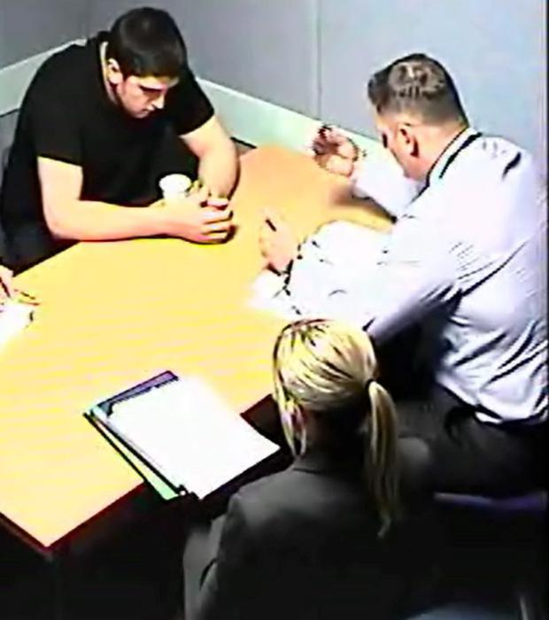 Handout picture from Scotland's Crown Office of Alexander Pacteau being questioned by detectives