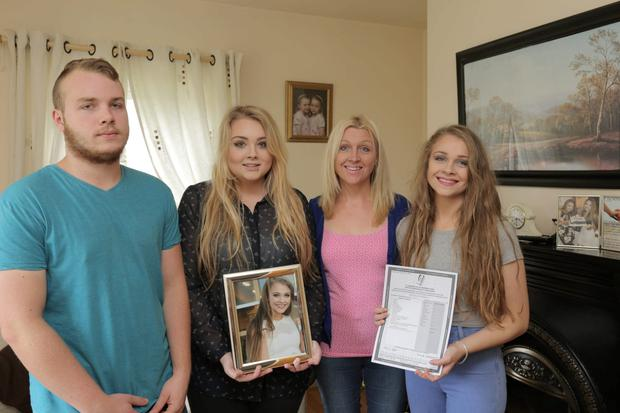 The family of Melissa Patterson who died in a road accident at their home in Castlebar, Co. Mayo. Her twin sister Belinda with her leaving cert results, her sister Samantha and brother Eamonn