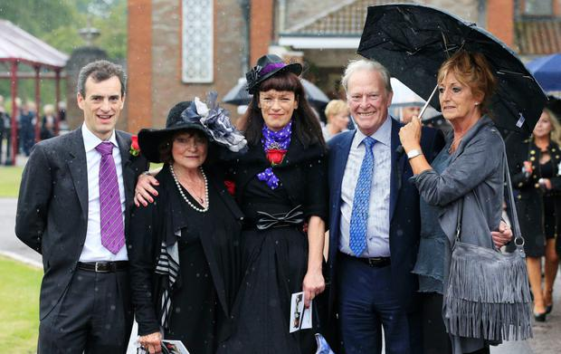 George Cole's family (left-right) son Toby Cole, wife Penny Morrell, daughter Tara Cole with Dennis Waterman and his wife Pam Flint at Reading Crematorium following the funeral of George Cole