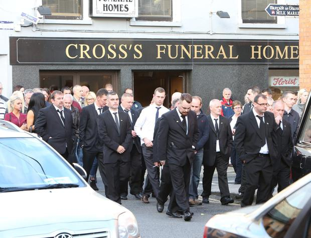 Mourners pay their respects at the removal in Limerick of Jason Corbett who was killed at his North Carolina home