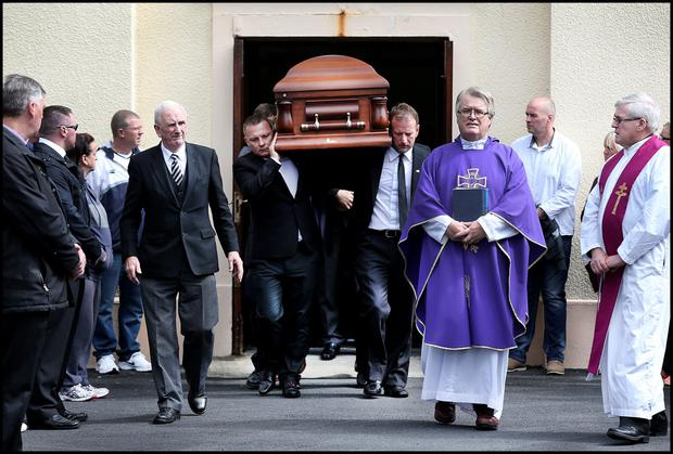 Jason Corbett's remains carried by David Lynch (front right) leave Our Lady Queen of Peace Church in Janesboro Limerick for burial at Castlemungret Cemetary.