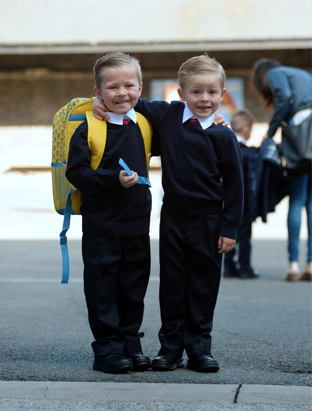 Carstin McDonald, 4, right, arrives for first day of primary school with his older brother Troy, 6. Gardiner Street Primary School, Belvedere Court