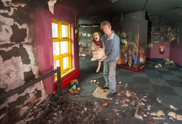 Liam Lambert shows some of the damage at the Lambert Puppet Theatre