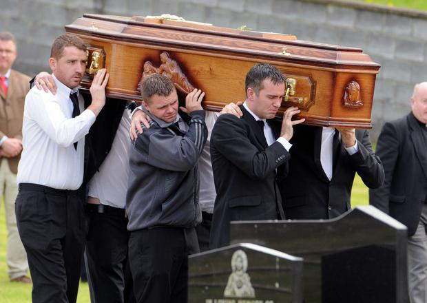 Bryan Whelan is carried to rest after his funeral mass