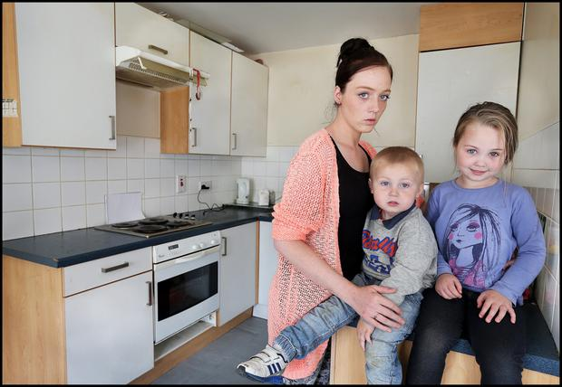 Tracey Smyth with her children, Ryan (2) and Alannah (4) at their home, No. 8 Carton Close, Ballymun, which has Pyrite.