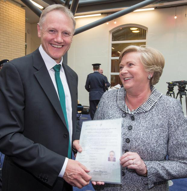 Justice Minister Frances Fitzgerald with Joe Schmidt during the citizenship ceremony in Dublin