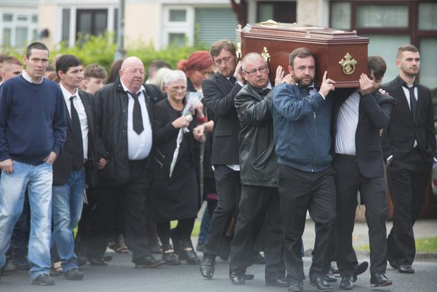 Mourners carry Karl Holmes' coffin to St Dominic's Church