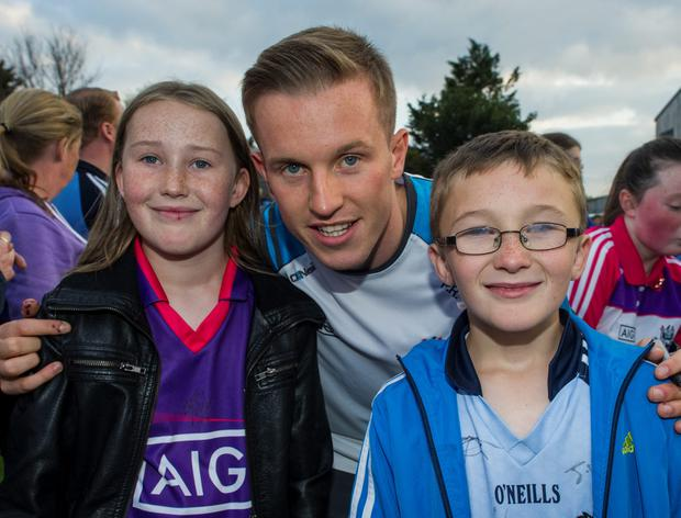 Wednesday 09 September 2015. Parnell Park. Dubs training and meet and greet with fans. Amy (10) and Adam (8) Moran from Drumcondra meet Philip Ryan.