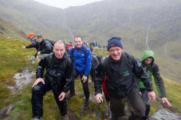 Journalist Paul Williams, INM Editor-in-Chief Stephen Rae, and former Ireland rugby player Mick Galwey climbing Carrauntoohil for the Caps to the Summit in aid of the Alan Kerins Projects, in partnership with Gorta Self Help Africa