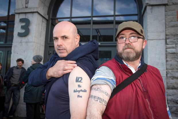 U2 fans Patrick Coughlan, Artane and Dave Griffith, Goatstown, queue outside the 3 Arena for tickets for U2's upcoming gigs in the 3 Arena, which go on sale at 9am on Monday morning. Picture:Arthur Carron