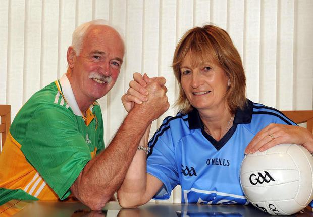Kerry football fan Denny Murphy battles with his Dublin born wife Breda as they look forward to the All Irealnd final
