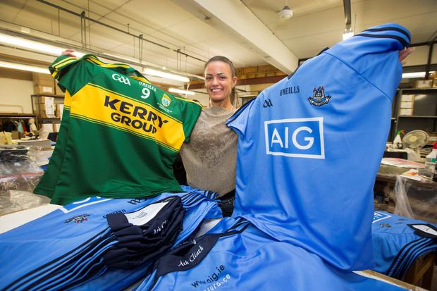 Gabriella Visockiene pictured with The Dublin and Kerry Jersey's at The O'Neills Factory at Walkinstown yesterday.