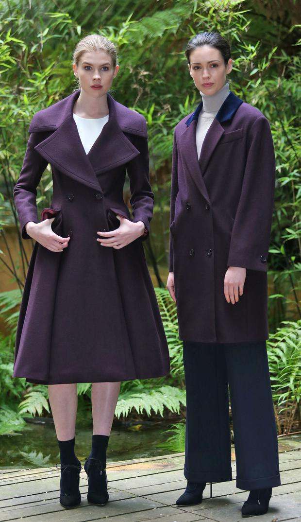 Eve Connolluy, left wears a plum fit and flare double breasted coat at EUR495, ivory crepe top at EUR155 and satin skirt at EUR220 and Louise Byrne wears a plum crombie coat with velvet collar at EUR395, navy trousers at EUR195 and stone polo neck sweater at EUR95 pictureed at the Hugh Lane Gallery, Dublin this morning for the launch of the Peter O'Brien for Arnotts Autumn Winter 2015 Collection.. Picture Colin Keegan, Collins Dublin.
