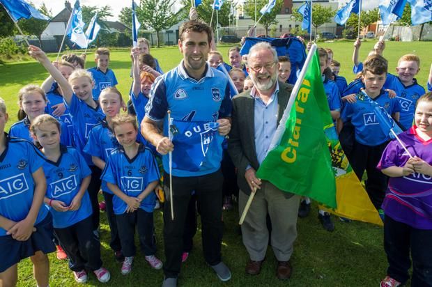 Holy Trinity SNS. Headmaster Jerry Grogan from Kerry with another teacher David Henry who is an ex-Dublin County player and their students in Dublin colours.