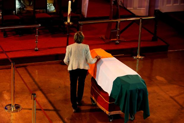 A relative of Thomas Kent touches his coffin at St. Michael's Garrison Church, Collins Barracks, Cork