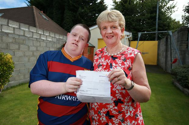 Philip Kelly from Dundrum, pictured with his mum Mary and the letter he recieved from Permanent TSB concerning an outstanding balance of 70cent