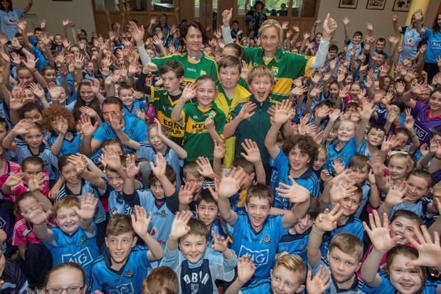 St Colmcilles Senior NS, Knocklyon. Kerry teachers in their county colours, Principal Lynn Corcorans and Noramai O'Sullivan surrounded by children from 3rd to 6th class.