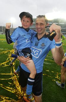Alan Brogan and his son Jamie celebrate after Dublin defeated Kerry in the All Ireland Football Final at Croke Park.
