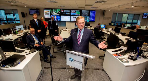 Enda Kenny opens the digital-led news hub watched by INM Chairman Leslie Buckley (seated) and Editor-in-Chief Stephen Rae