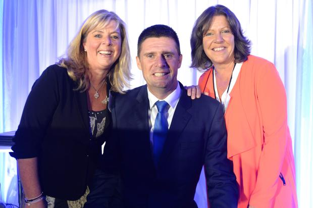 Niall Quinn with Sharon Dagg and Karen Tracey of Down Syndrome Centre at the Dublin Bus Spirit Initiative Awards at Croke Park.