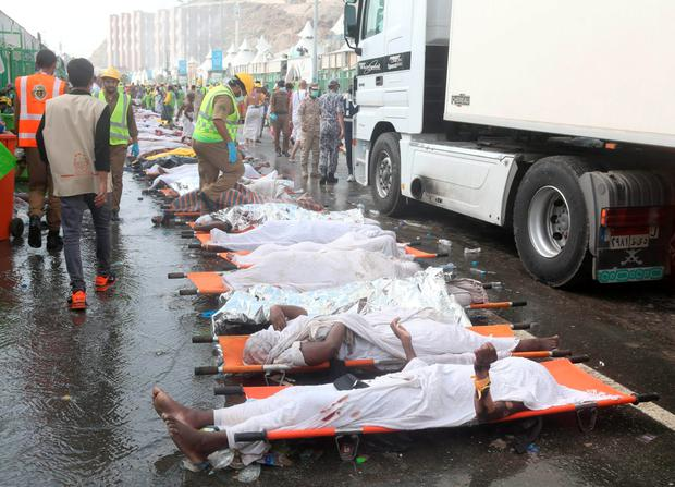 Bodies of those killed in the crush are laid out to be taken away